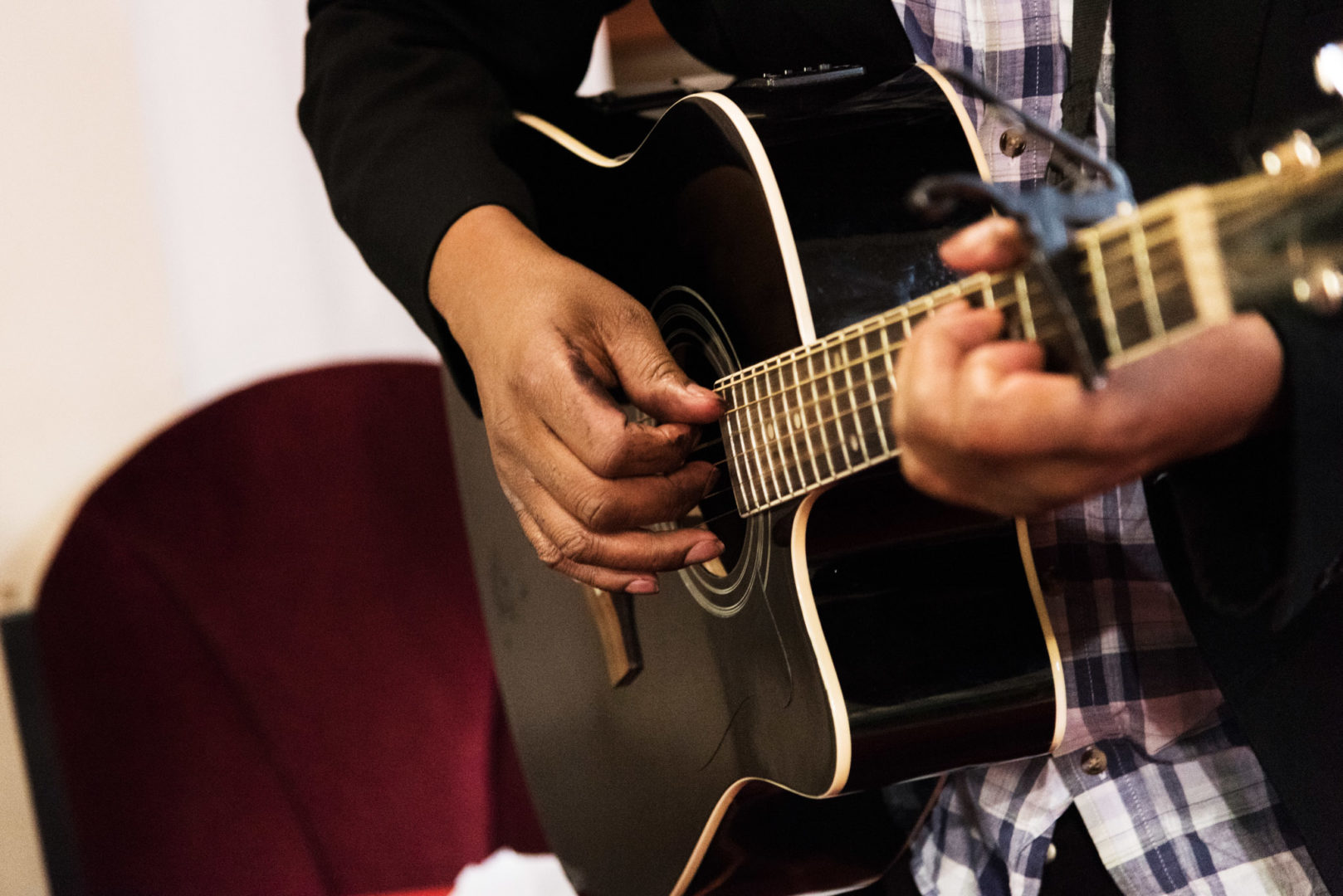 A musician oplays a guitar at St Mary's Church in Coventry