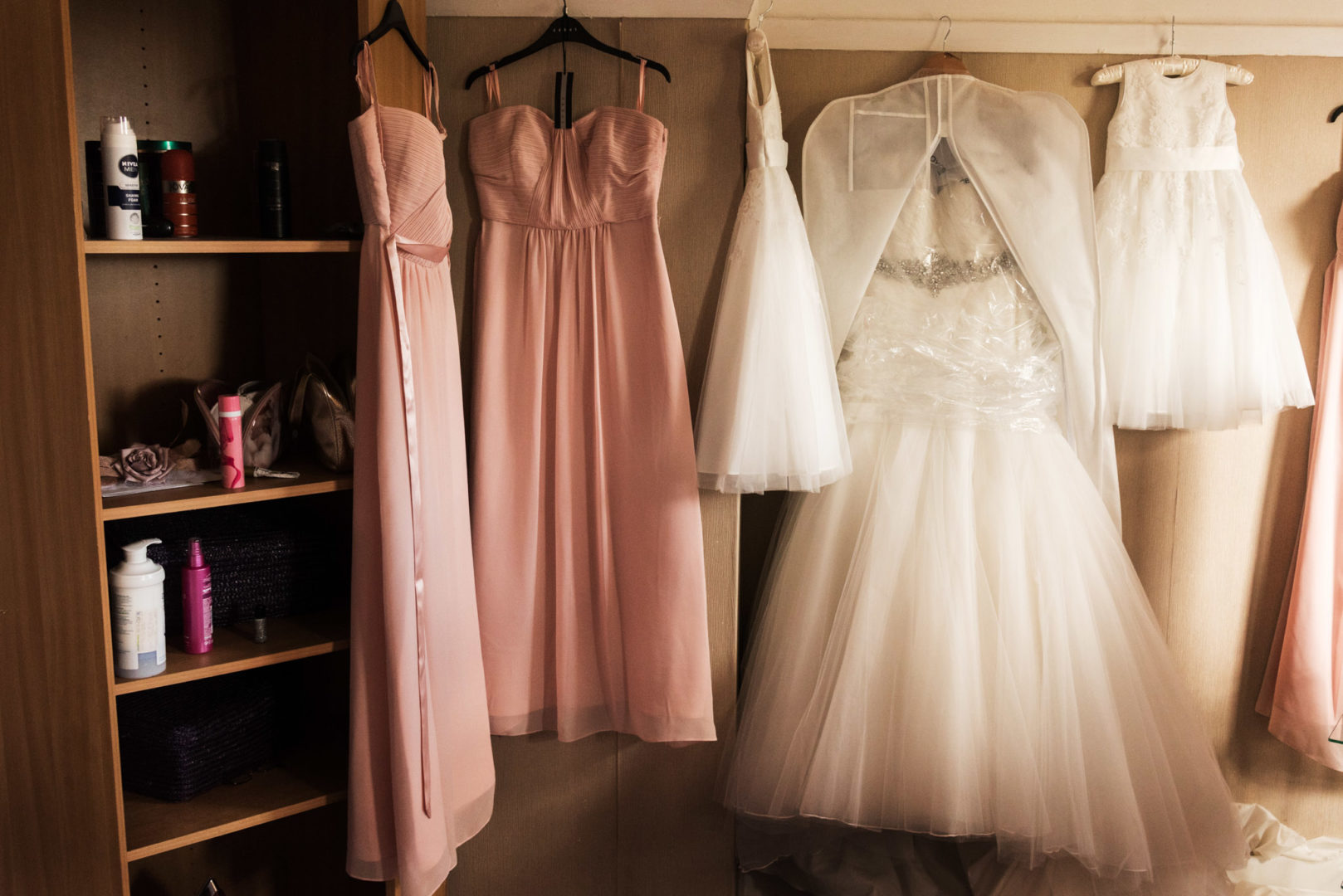 Wedding dresses hang in a bride's room in Coventry